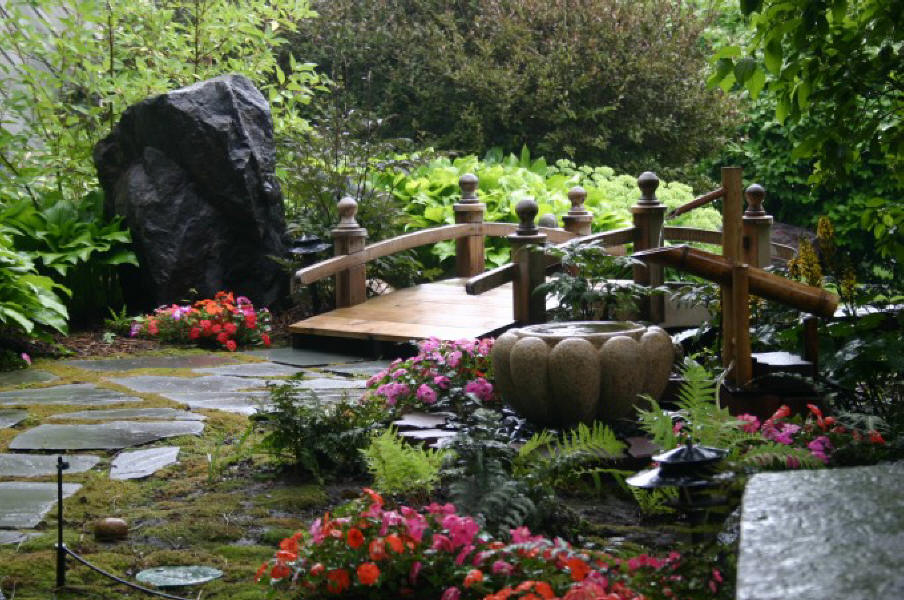 japanese-garden-bridge-design-with-big-stone-black-color