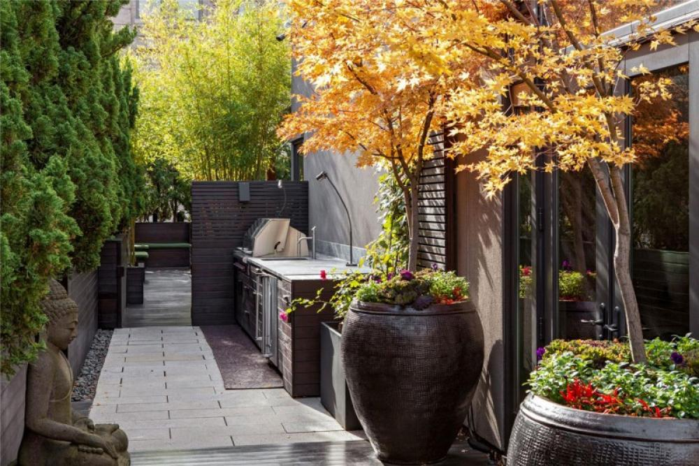 Asian Statue With Oversized Planters In Minimalist Outdoor