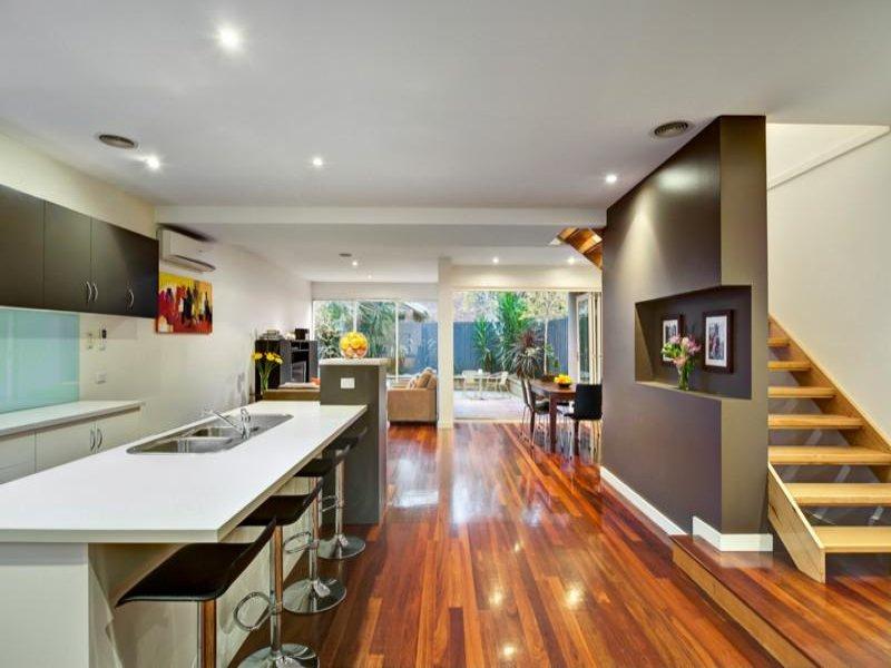 Modern open plan kitchen design using laminate