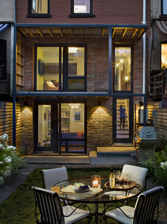 eclectic-patio-with-outdoor-lounge-wirh-round-table-glass-with-arm-chair1