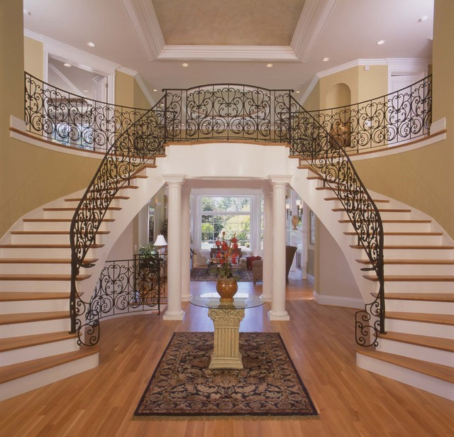 traditional-entry-hiring-dramatic-marble-elevations-columns-flower-arrangement-foyer-stairsentry