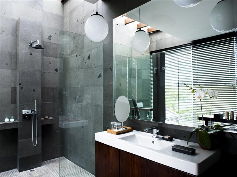 white-hanging-light-fixture-above-vanity-paired-with-cubical-shower-for-appealing-bathroom-design