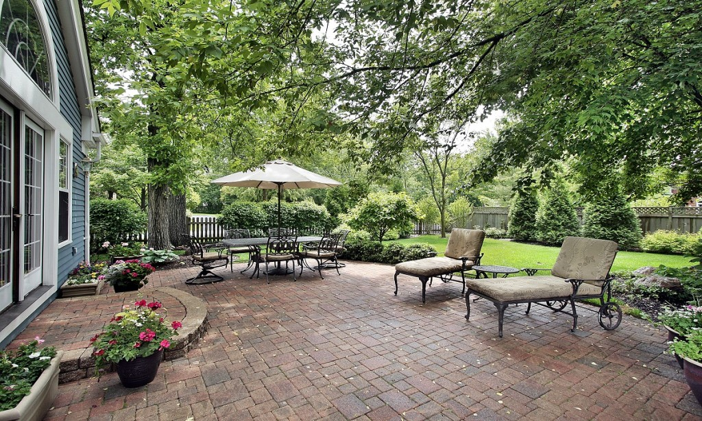 bigstock-Brick-patio-with-table-umbrell-