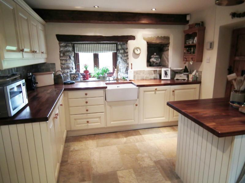 photo of farmhouse kitchen beige brown kitchen