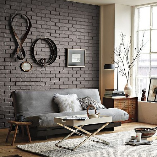 Black-brick-wall-decoration-with-contemporary-belt-ornaments-design