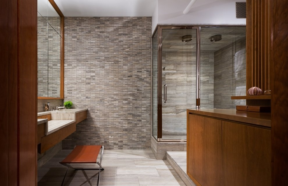framed-bathroom-with-stone-feature-wall-and-double-shower