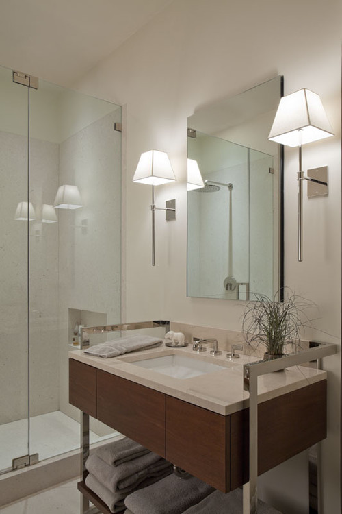 modern-bathroom-lighting-ideas-with-wall-sconces-in-both-sides-of-mirror