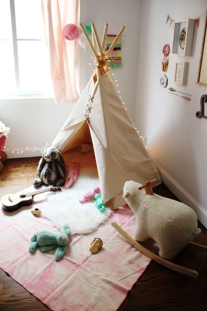 Simple-white-teepee-with-lots-of-toys-