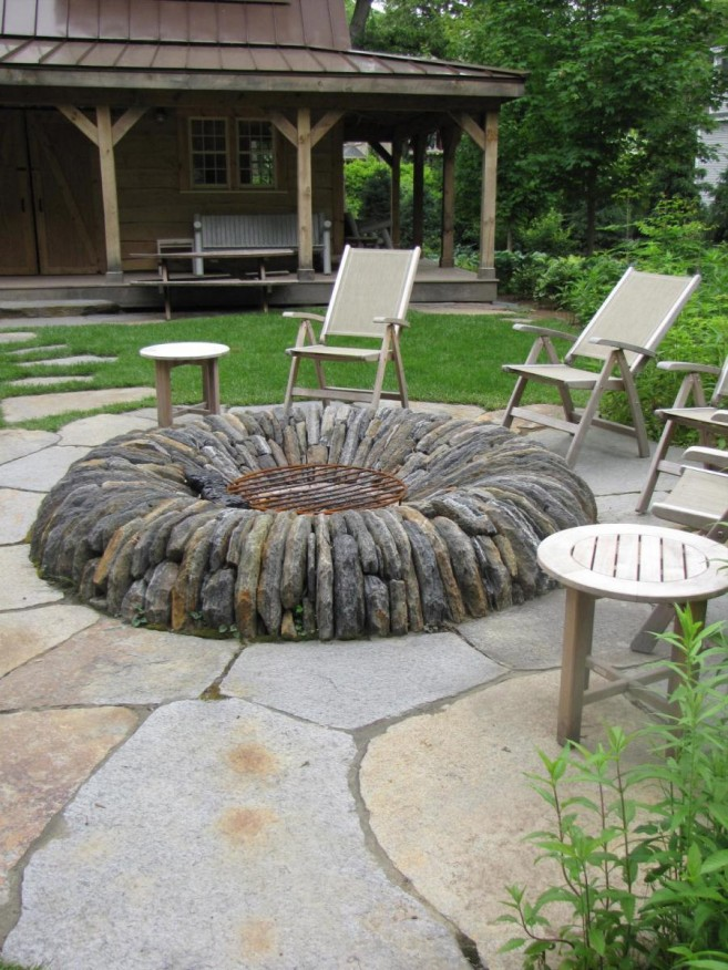 white-lounge-chairs-with-decorative-fire-pit-stone-design-filled-on-outdoor-classic-park-