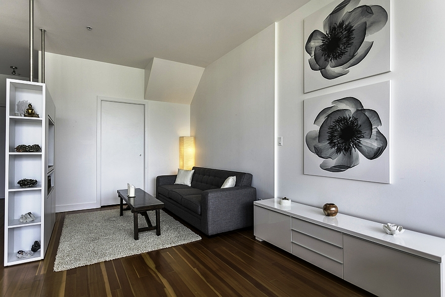 Compact-living-space-in-white-with-wall-mounted-entertainment-unit