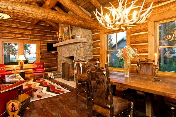 Rustic-living-room-design-stone-fireplace-wood-table-antler-chandelier
