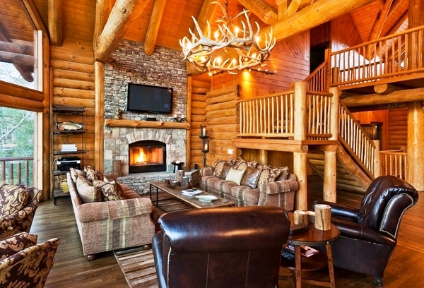Rustic-living-room-stone-fireplace-round-antler-chandelier