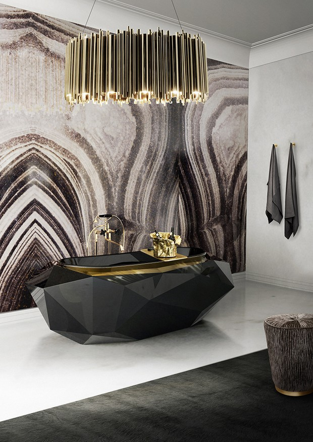 Luxury bathroom with gold and raw material combination.