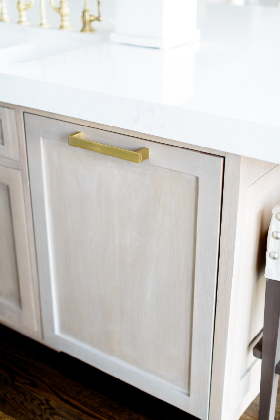 All White Kitchen Cabinet With Golden Accesories