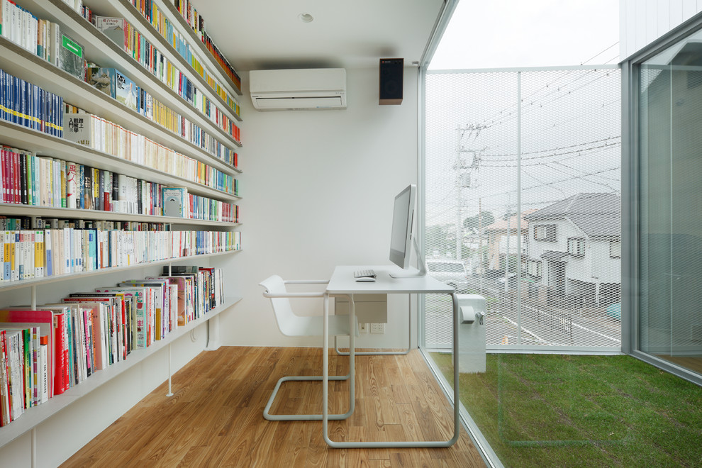 Modern Open Home office With Library Thewowdecor
