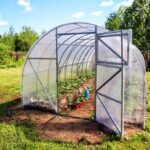 How to Build a Hoop House Style Greenhouse on a Tight Budget