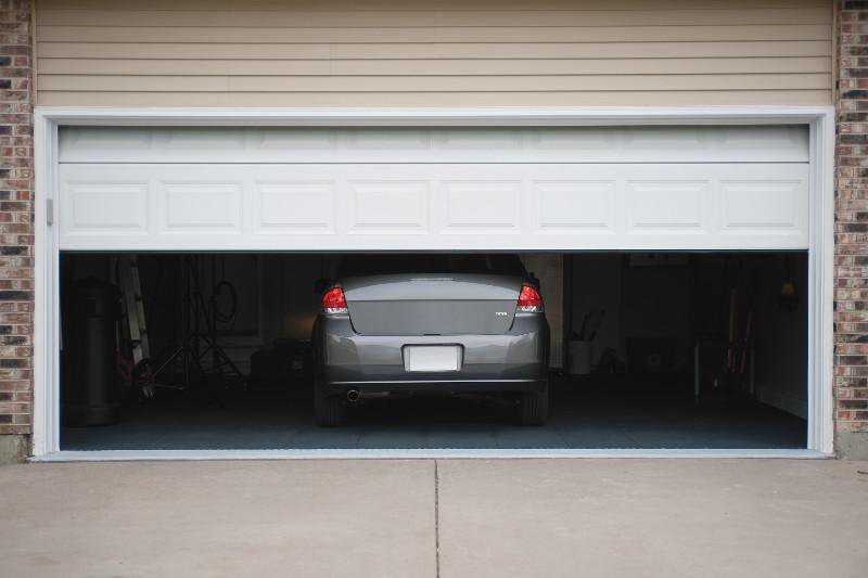 Never leave garage doors partially open