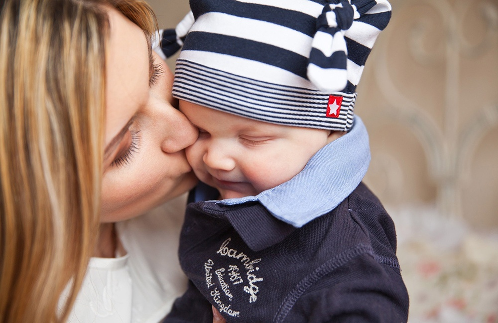 Mom kissing baby boy