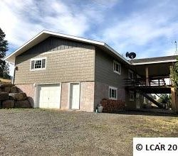 Big family size home with acreage.