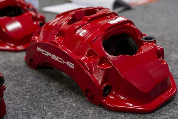 red powder coated Porsche brake caliper