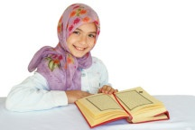 Little girl reads Quran and smiles