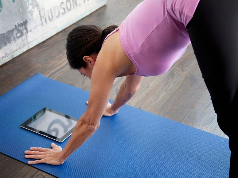 Woman with Yoga mat watching Bootylates
