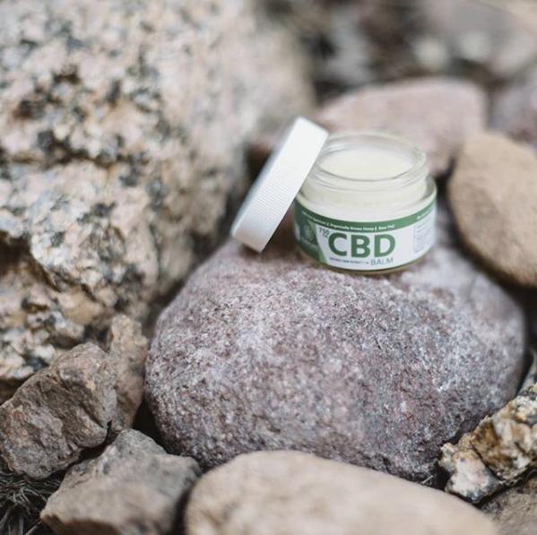CBD jar on rocks