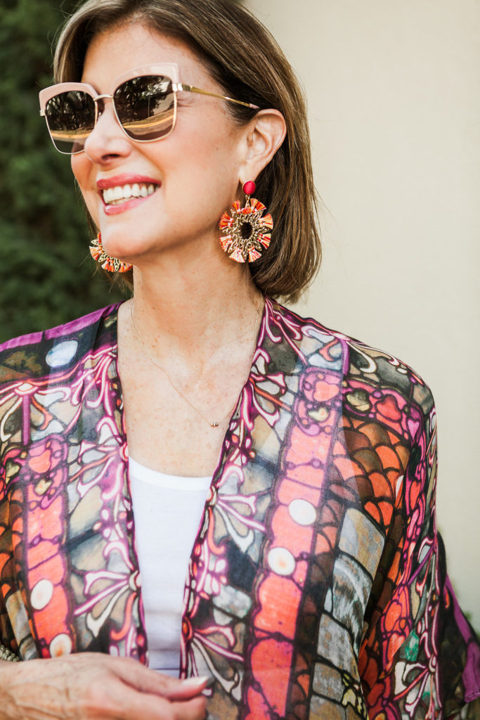 Orange is such a neutral color and love pink sunnies and tassel earrings.