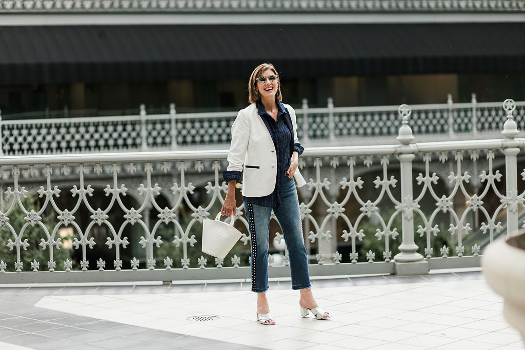 Fashionomics over 50 blogger showing white corduroy blazer for fall