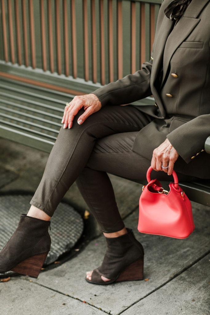 a pop of red in accessories adds to olive green outfit