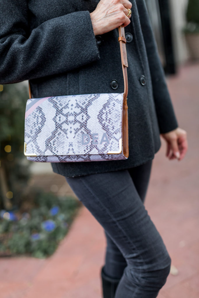 Snakeskin cross body with gray and pink trim and monogram