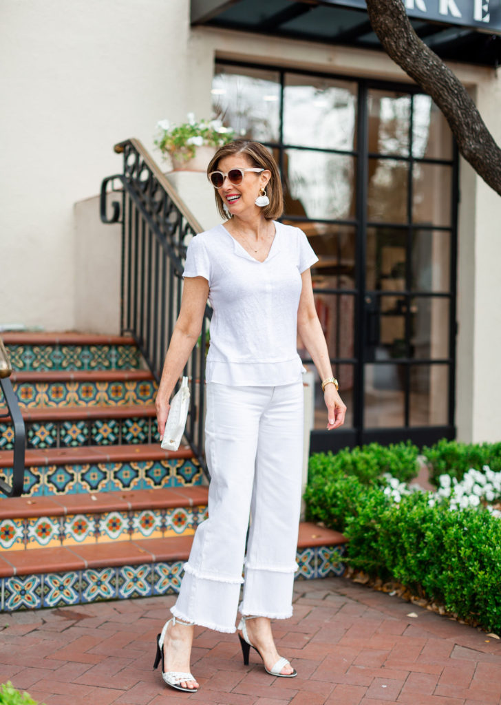 White denim with white sandals and handbag