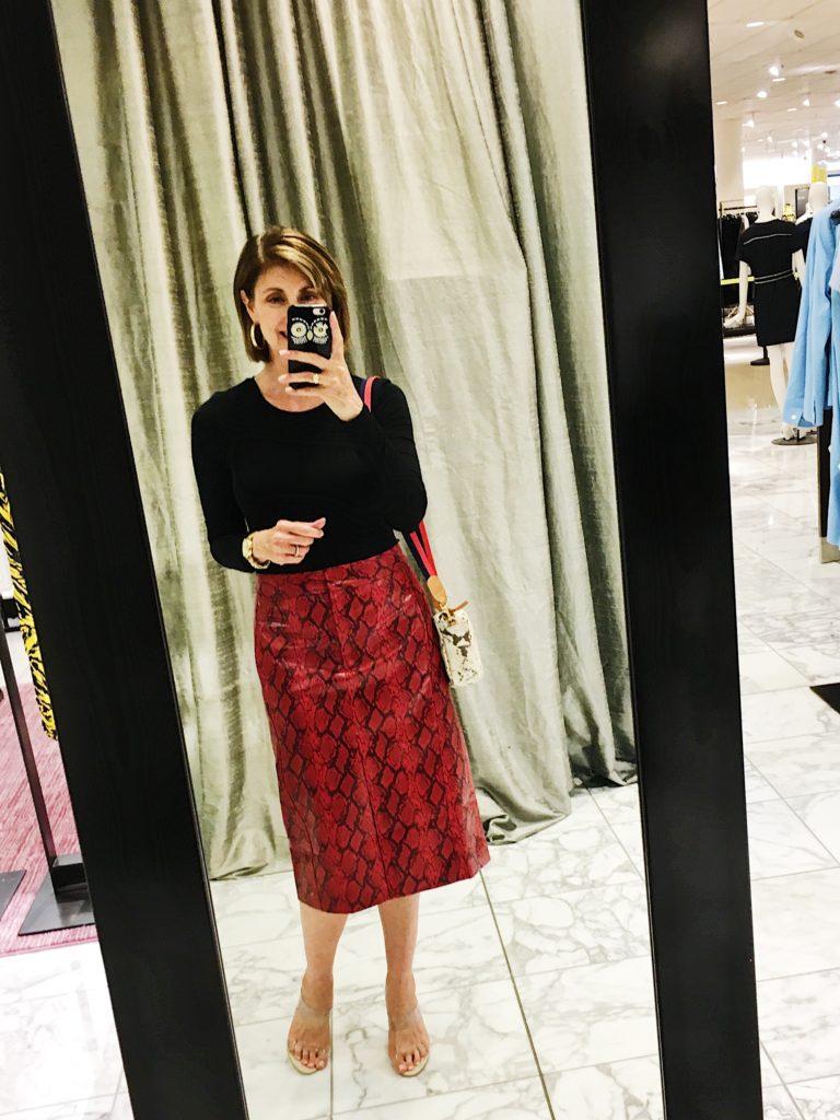 Over 50 blogger in Tibi red snakeskin skirt