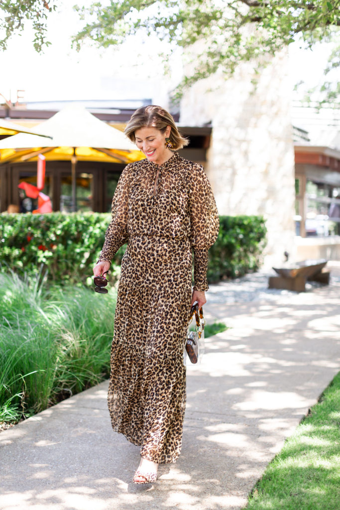 Over 50 blogger wearing leopard sandal with leopard dress