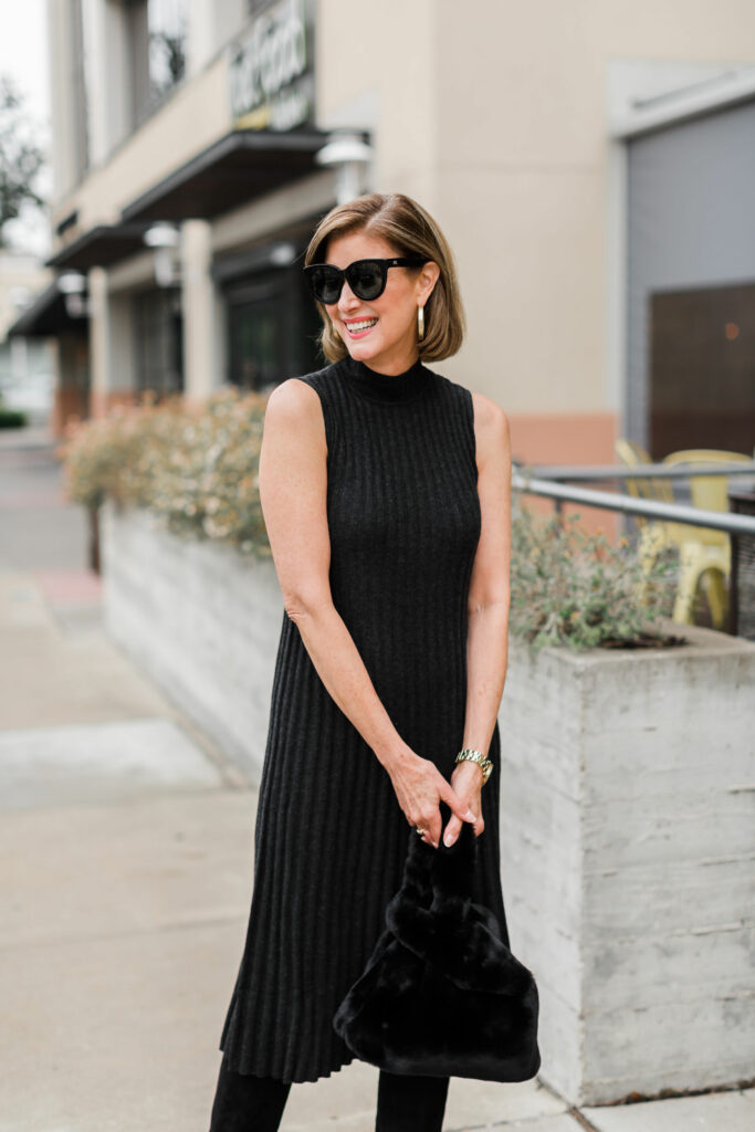 Black dress with knee high boots on over 50 blogger