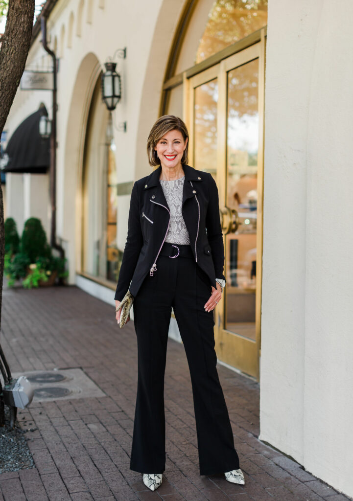Dallas Blogger in black zipper jacket with snakeskin top