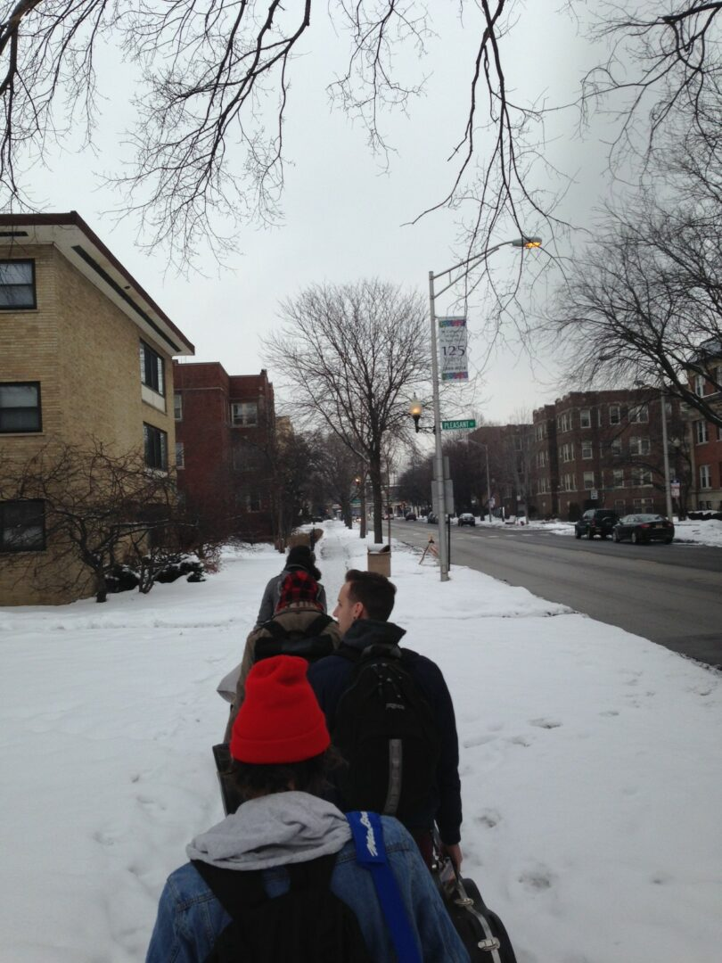 The boys trekking back to the van in Chicago on a snowy Sunday morning.