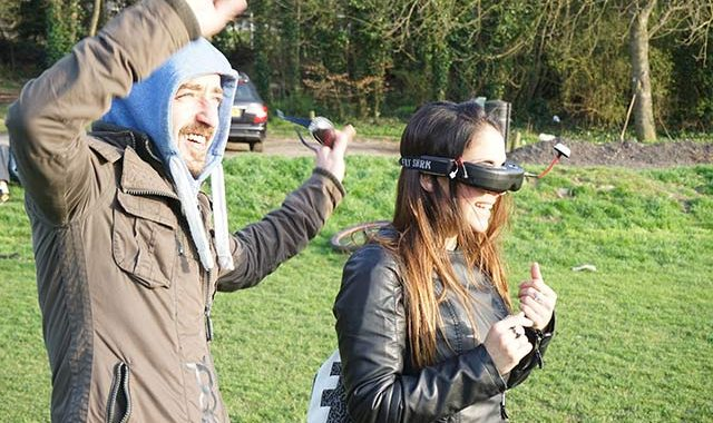 Sharing The Drone's Eye View By Passing The Goggles Round.