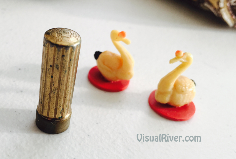 Tiny lipstick and little plastic Swans
