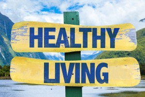 Healthy Living sign with mountains background