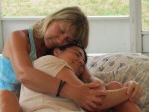 image of Niki cuddling with a woman