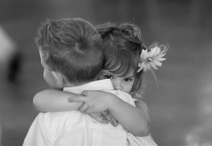 hugging two children