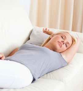 woman sleeping on a couch - relaxation techniques