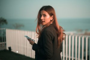 women using phone - protect your skin against HEV damage