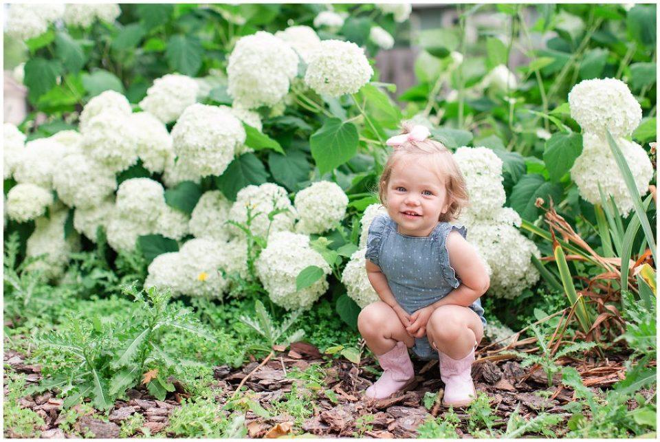 Toddler photo with flowers | Iowa Baby Toddler Photographer | CB Studio