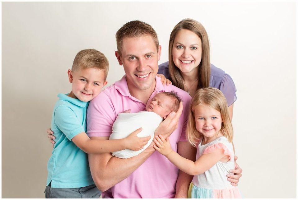 Newborn family pose   Iowa Newborn Photographer   CB Studio