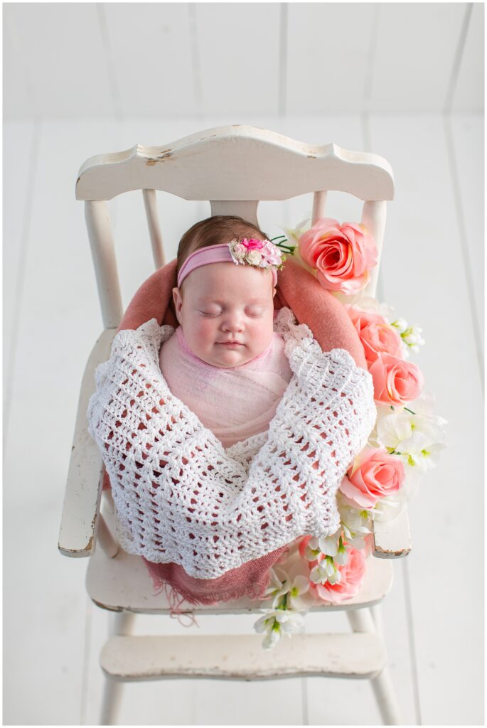 Baby pose with pink wrap and florals in a bucket | Iowa Newborn Photographer | CB Studio