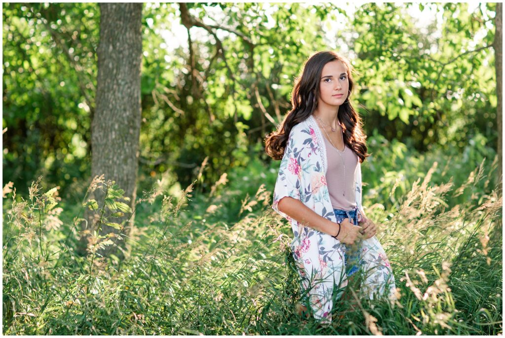 grassy field senior picture ideas | Iowa Senior Photographer | CB Studio