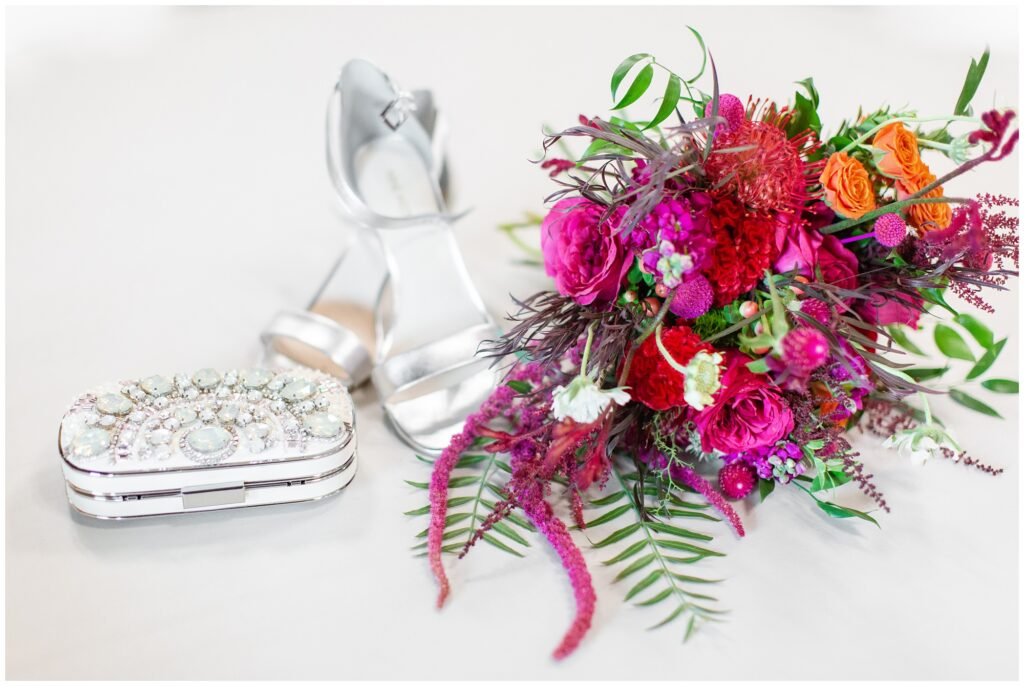 Fuchsia and pink wedding bouquet with lots of fun textures and jewel encrusted hand clutch | Iowa Wedding Photographer | CB Studio
