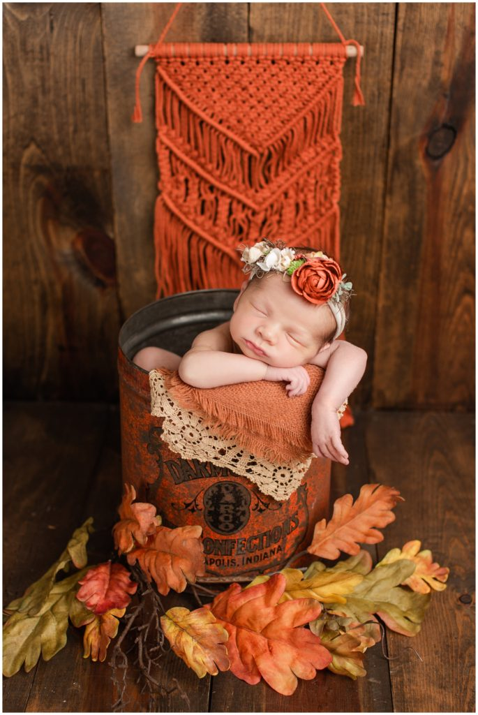 Fall Newborn posed in an orange, rustic bucket with lace, fall leaves, burlap and macrame details | Iowa Newborn Photographer | CB Studio